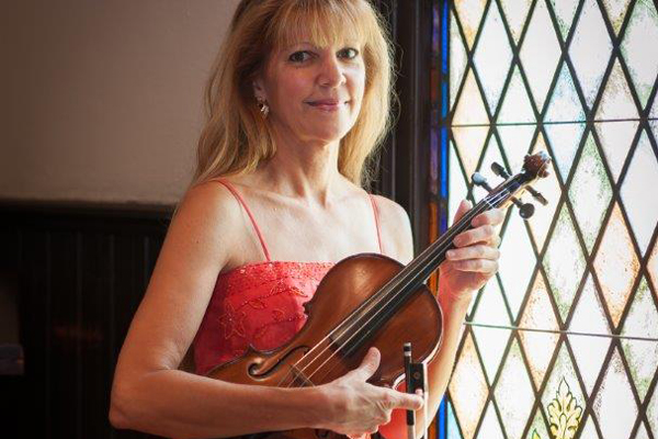 Christine with violin near window