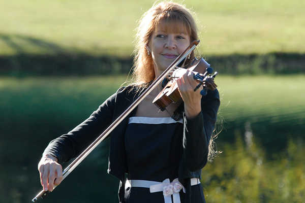 Christine playing violin at wedding